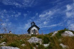 Chapel of Matajur. The chapel of Christ the Redeemer Cristo redentore on the top of Matajur, a mountain on the border between Italy and Slovenia, in a sunny day Royalty Free Stock Photo