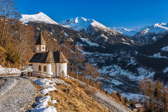 Chapel in the mountains overlooking the town of Bad Gastein. Austrian Alps. Stock Images