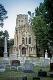 1912 Chapel, Mt. Hope Cemetery. The 1912 Chapel stands behind grave markers at Mount Hope Cemetery in Rochester, New York, July 2018 Stock Photography