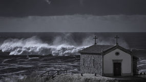 Chapel near stormy sea Stock Images