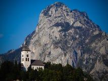 Chapel next to mountain. Little chapel next to mountain Traunstein, Austria Stock Photo