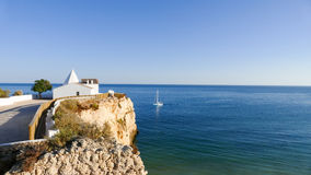 Chapel of Nossa Senhora da Rocha, Portugal. Algarve, Porches. This ancient fort is placed in a rocky spot over the sea - National Trust Building Royalty Free Stock Photography