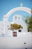 Chapel in Oia, Santorini. Arch with cross above chapel in Oia, Santorini, Greece Stock Image