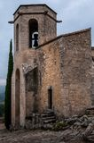Chapel , oppede le vieux , french hilltop village . Chapel , Oppede le vieux ,old hill top village in the south of france , provence , in the clouds Stock Photos