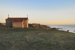 Chapel overlooking the ocean at sunset royalty free stock image