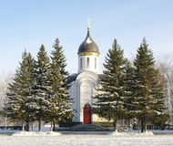 Chapel in park of Victory Day.Omsk.Russia. Winter view. Russia. snow-bound fir-trees and chapel Royalty Free Stock Photos