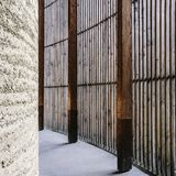 Chapel of Reconciliation, Berlin Wall Memorial Park, Berlin, Germany. View through the outer wall of the Chapel of Reconciliation. Out wall consists of timber Royalty Free Stock Image