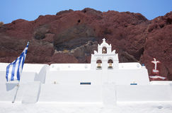 Chapel in red beach, Santorini Stock Images