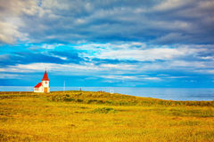 Chapel with red roof on fjord Royalty Free Stock Photo