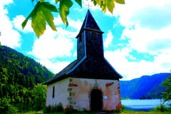 The chapel of retournemer lake Stock Image