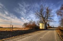 Chapel on the road. The March afternoon with a chapel at Country Roads Royalty Free Stock Photos