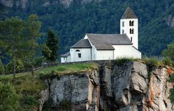 Chapel on rock. White chapel on rock in the Alps stock photo