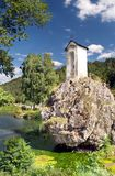 Chapel on the rock. Small chapel on the rock above the lake Royalty Free Stock Images