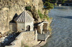 Chapel on the rock above Kura river in Tbilisi stock images