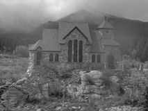 A chapel in the rocky mountains. Black and white Stock Photo