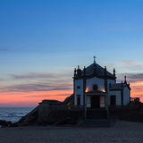 Chapel Senhor da Pedra at dusk, Miramar Beach, Portugal. Travel. Royalty Free Stock Photography