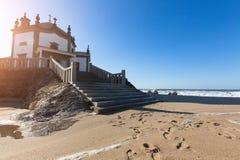 Chapel Senhor da Pedra at Miramar Beach, Atlantic ocean near Porto Royalty Free Stock Photo