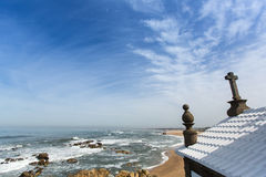 Chapel Senhor da Pedra at Miramar Beach, Atlantic ocean near Porto, Portugal. Royalty Free Stock Images
