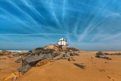 Chapel Senhor da Pedra at Miramar Beach, Atlantic ocean near Porto. Royalty Free Stock Photo