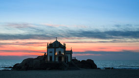 Chapel Senhor da Pedra at Miramar Beach at night time, Atlantic ocean, Porto Stock Images