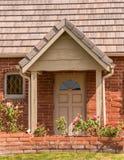 Chapel side door. House entrance door with half moon lite and cape hood Stock Photos
