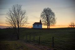 Chapel on the hill at sunset. Chapel silhouette on the hill at sunset. meditation place bavaria stock photos
