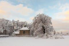 Chapel in snow Stock Photo
