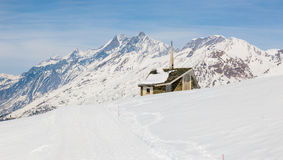 Chapel on the snow mountain with the background of Matterhorn. Zermatt. Switzerland stock photography