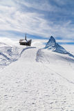 Chapel on the snow mountain with the background of Matterhorn Stock Photo