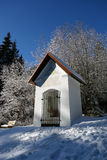 Chapel in the snow under blue sky Stock Photos