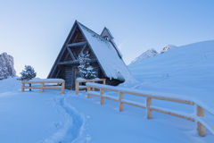 Chapel in a snowy. Landscape of the Dolomites Stock Photography
