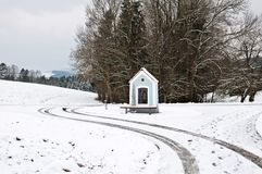 Chapel in a snowy landscape in winter Stock Images