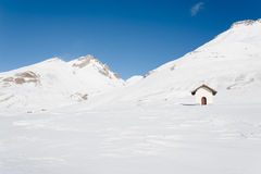 Chapel among snowy mountains Royalty Free Stock Photography