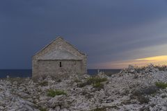 Chapel St Ivan at Punta Planka in Razanj Croatia. Beautiful old stone house in summer evening close Adriatic Sea in Dalmatia. Nice Royalty Free Stock Photo