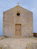 Chapel of St Mary Magdalene, Malta. With closed entrance door, on the background of cloudy sky Royalty Free Stock Image