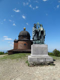Chapel and Statue of Saint Cyril and Methodius. Wooden chapel and bronze statue of Saint Cyril and Methodius on Radhost in Beskydy Mountains, Czech Republic. The Stock Photos