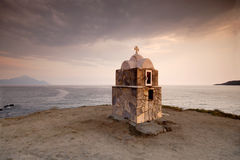 Chapel in the storm. A small greek chapel in a dark storm Stock Photo