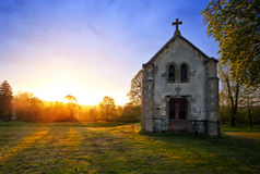 Chapel and sunset. An old chapel during a blazing spring sunset Stock Images