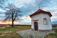 Chapel at sunset landcape with tree Royalty Free Stock Photography