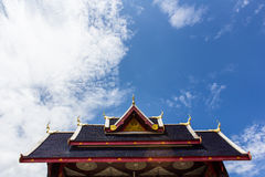 Chapel in Thai temple architecture against blue sky Stock Images
