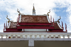 Chapel in Thai temple architecture against blue sky Royalty Free Stock Images