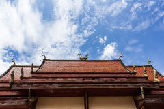 Chapel in Thai temple architecture against blue sky Stock Image
