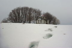Chapel with tracks in winter Royalty Free Stock Photography