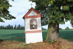 Chapel by the tree. Chapel in the meadows by the tree stock photo