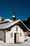 Chapel under the snow in the mountains Royalty Free Stock Photo
