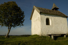 Chapel in upper Bavaria. Quaint white chapel with tree standing beside it, in upper Bavaria Stock Images