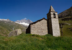 Chapel of valley of Aveyrolle in Maurienne, France. Stone chapel of valley of Aveyrolle in Maurienne, France and view of moutains Stock Photo