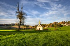 Chapel of the village. Autumn scene from the Bavarian countryside with a chapel Stock Photo