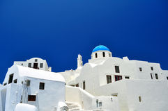 Chapel and white houses in Santorini Island Stock Photos