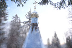 Chapel in winter forest Stock Images
